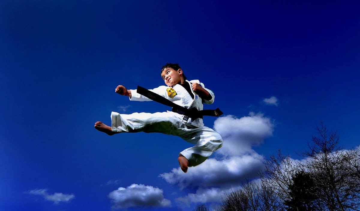 A six-year old boy fighting arthritis is the world's youngest black belt!