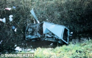Incident photo: Louise's blue Fiat Panda at the bottom of the deep ditch off the Bukehorn Road between Newborough and Thorney.  A young woman who defeated impossible odds of survival after a car accident as a child is set to run more than 5 km.  See MASONS story MNRUN; A woman who overcame near-impossible odds after a car crash when she was three years-old is about to run 5K for the charity which saved her life. Rebekah (corr) Cheshire had to re-learn virtually all the basic life skills - how to walk, talk, hear, sit, eat and see - after the horrific accident. Her mother was driving her to nursery in 1994 when she lost control on an icy road and ploughed into a 10ft ditch. Rebekah suffered two brain brain haemorrhages and had to be brought back to life twice in the ambulance on the way to hospital. Doctors told her mum Louise Donaldson to say goodbye to her daughter as scans showed an almost impossible chance of survival. And she was warned if Rebekah did make it there would be an 85 per cent chance she would need 24-hour care. But Rebekah, now 23, made an incredible recovery and lives semi-independently in Peterborough, Cambs. close to her family