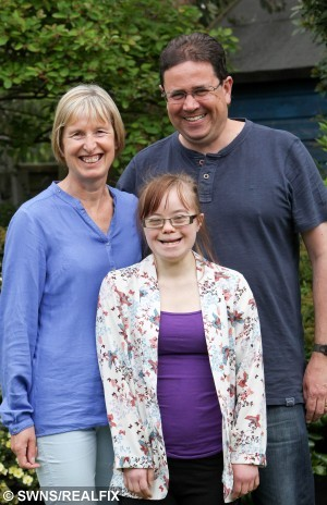 "Beth Gardiner (20) with mother Judy and father Mike.  A girl with Down's Syndrome is aiming for the West End after she became the first person in the UK with the condition to make it onto a national training scheme for talented young dancers.  See NTI story NTIDANCER.  Award-winning Beth Gardiner, 20, has been dancing since she was five and used it as a way of getting her ""tears out"" and expressing herself as a child.  The contemporary-style dancer has been enrolled on the Centre for Advanced Training (CAT) scheme since September 2013 and has performed on stages all over Nottingham.  The programme aims to give young dancers the skills they need to make it as professionals and has already helped some bright young stars to achieve their West End break.  Ambitious Beth, a dance teaching assistant with Oakfield Dance in Nottingham, won a prize for dance at the Young Creative Awards ceremony at Nottingham Playhouse earlier this month.  But now she has the West End firmly in her sights and hopes her story will inspire other young people with disabilities to follow in her footsteps.  Yesterday (Tue), Beth - who trains for 10 hours a day - said she has had to endure being ""stared at"" by people in the street and being ignored by others in group conversations."