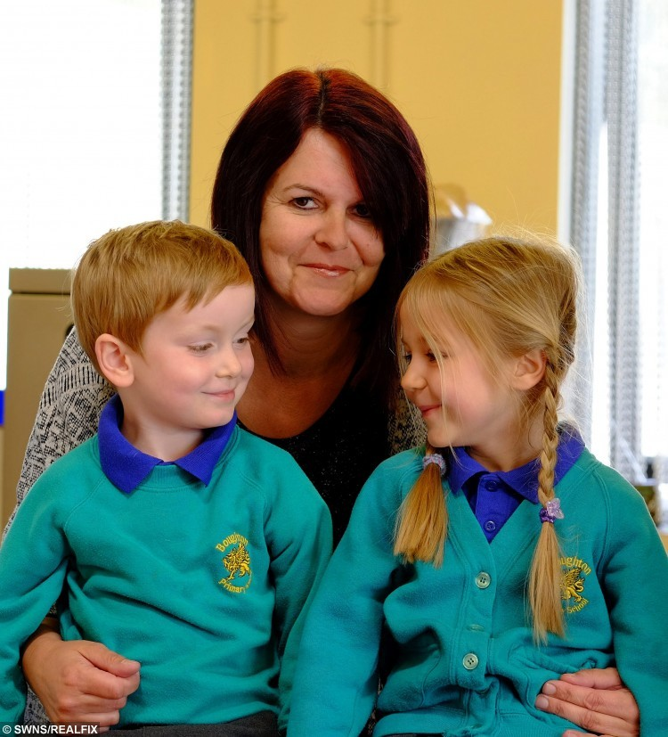 Dexter Wilson (4) & Emma Hayes (5) with Jodie Knighton.  A five-year-old girl has been hailed a hero after she leapt into action to save the life of her best friend who was choking on his school dinner.  See NTI story NTICHOKE.  Reception pupil Emma Hayes was sitting with her pal Dexter Wilson, four, in her primary school canteen eating their lunch last Thursday (30/4).  But during the meal Dexter started to gasp for air after he began choking on a piece of sausage, which became lodged in his throat.  Remembering techniques she learned from her older brothers the quick-thinking youngster bent him forward and began hitting his back.  Lunchtime supervisor Jodie Knighton, 45, also rushed to the schoolboy's aid and between them they were able to dislodge the meat.  Yesterday (Thurs) Emma's proud mum Stacey Phillips praised her daughter's efforts following the drama at Boughton Primary School, in Northampton.