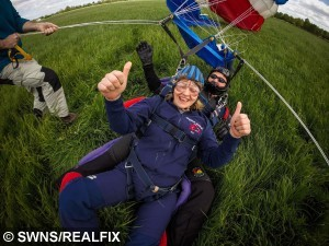 Debbie Allmark, 35, is pictured during her sky dive on May 16 2015. Ms Allmark has managed to lose over 12 stone in 2 years to go from weighing 25 stone to 13 stone. See NTI story NTIFAT: A super-slimming mum who weighed more than 25 stone shed half her bodyweight to complete her lifelong ambition - of SKYDIVING. Debbie Allmark, 35, tipped the scales at a hefty 26 stone at her heaviest and was stopped from going on some rides at Disney World in Florida on a family holiday in 2013. The mum-of-two was also left humiliated in 2012 after a rollercoaster at Alton Towers Resort stopped whilst she was on it because of her bulky frame. Debbie eventually decided to fight her flab when she discovered she was too porky to complete her lifelong ambition of completing a skydive. Incredibly, the pawnbroker lost half of her bodyweight in less than two years and now weighs a healthy 13 stone
