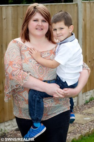 "Henry Davies with mother Chloe Davies. Henry has been praised by paramedics for calling an ambulance when his mother Chloe lost consciousness after falling, Coundon, Coventry.  A four-year-old boy has been hailed a hero after he calmly called 999 when his mum fell over and knocked herself out.  See NTI story NTIHERO.  Little Henry Davies did not panic but instinctively phoned the emergency services after his mother Chloe, 29, tripped and banged her head on the living room table at their home.  Henry told the operator what had happened, directed paramedics to the house in Coundon, Coventry, and even offered the ambulance crew a drink once they arrived.  Henry, who only turned four last month, also phoned his dad, Ian, who was driving at the time, to tell him what had happened to Chloe.  His swift actions last Thursday (21/5) have been praised by West Midlands Ambulance Service who described his initiative as ""amazing"".  Proud dad Ian, 35, said: ""Chloe has been unwell with glandular fever which has made her feel quite poorly.  ""I left for work early at about 7.30am and as she got up after I went she felt quite dizzy and faint and stumbled."