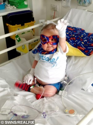 "Five-year-old hero Seth Lane gives a Superman salute as he prepares to undergo a life-saving bone marrow transplant – from his DAD.  See NTI story NTIBUBBLE.  The youngster, who lives in a 'bubble' due to a rare immune disorder, underwent the procedure and bravely said he was getting better thanks to ""Daddy's magic.""  Seth was born without an immune system and has lived in a sterile germ-free environment for more than half of his short life.  Following an unsuccessful bone marrow transplant his own cells turned on him, and since January he has been forced to live in a single hospital room which he can't leave.  Despite the disappointment, Seth was scheduled for another bone marrow transplant from his dad Nik (corr).  He captured the hearts of the nation when he recorded an adorable video asking people to wear his favourite colour yellow to give him luck for the procedure on May 1.  His parents Leanne and Nik, from Corby, Northants., were astonished when the video went viral and racked up nearly 2,500,000 views on YouTube in a matter of days.  Hundreds of thousands of strangers worldwide pledged to wear yellow and send photos which will be used to decorate Seth's hospital room to show he's not alone."
