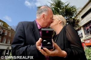 """Paul Anstis and Gloria Anstis picking up their wedding rings at H Samuel in Plymouth. Childhood sweethearts who met at school in Plymouth and were separated for 50 years have travelled the globe to pick up their wedding rings in the city where their story began. Paul Anstis and Gloria - nee Jenkins - left their home in Australia and travelled back to where their romance blossomed 55 years ago to pick up their wedding rings from H Samuel, in New George Street, Plymouth. The lovebirds first met at Plympton Grammar School, now Hele's School, in 1960 when Paul was 13 and Gloria, who has already legally changed her name to Anstis, was just 12 years old. """"It was one of those kinds of moments where you caught sight of each other across the playground,"""" said Paul, now aged 68."""