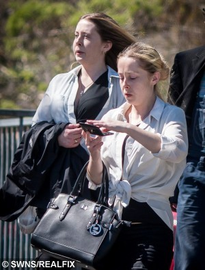 """Constance and Penelope Harris arriving at Truro Magistrates' Court. SWTWIN: Identical female twins Penelope and Constance Harris, 25, of Porthleven in Cornwall have been jailed for 18 weeks and 14 weeks respectively in Truro for a string of robberies of food and alcohol from supermarkets. The court heard they were """"distracting"""" staff in supermarkets to steal food and alcohol."""