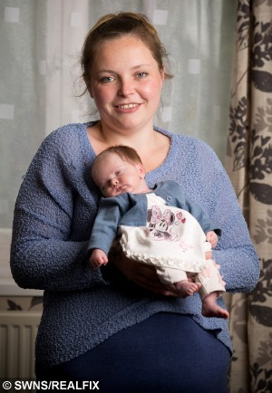 "Proud mum Louise Nutley with her daughter Freyah pictured at home in Frome, Somerset. See SWNS story SWGIRL; A mum no longer feels so outnumbered in her own house after she gave birth to a baby girl - after having SEVEN boys. Louise Nutley, 31, has always wanted a baby girl and was twice told at scans that two of her boys were going to be girls. She had given up hope of having a fellow female to do ""girly things"" and even joked at her last scan that they ""didn't need to be told the sex"". But all her dreams came true after little Freyah May Grace was born on April 10, five weeks premature and weighing just 3lbs 12oz."
