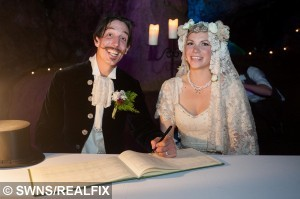 Chris Bull, 37, (left) and Phoebe Baker, 25, (right) pose for  a portrait after their wedding ceremony in Wookey Hole Caves near Wells, Somerset, England. May 1 2015. Chris Bull, 37, and Phoebe Baker, 25, got married in the caves having both walked the high wire, meeting in the middle.  See SWNS copy SWWIRE : This is the moment a couple took their romance to new heights by exchanging vows - on a tightrope 25 metres off the ground. Chris Bull - in full morning suit - and Phoebe Baker - in a flowing white wedding dress - started from opposite ends of the 75 metre-long highwire before meeting in the middle. They then said 'I do' over the heads of around 100 friends and family watching on from the ground at Wookey Hole in Somerset. The event - billed as the UK's first-ever highwire wedding - was always on the cards for the daredevil couple. Chris, 37, a professional rope walker, fell for Chloe, 25, at a circus show where she was a costume designer.