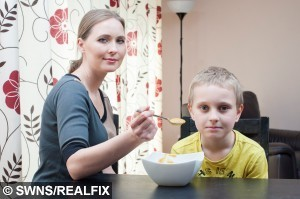 """Ocean Russell, 7, (right) poses for a portrait with his mother Oxana Russell, 36, (left) at home in Severn Beach, England. May 19 2015. Ocean Russell will only eat liquid foods.  See SWNS story SWCHOKE; A """"skeletal"""" schoolboy with a rare phobia of choking is so afraid he can only eat Weetabix and SOUP. Ocean Russell, seven, started rejecting solid foods when he was four-years-old after his tonsils became swollen, giving him problems eating and sleeping. But his anxiety became so severe he is now only able to eat soft mushed up cereal, soup, liquidised baked beans and mashed potato - and only under the supervision of his mum. The little lad hasn't gained any weight in the last two years and refuses to eat at school, leaving his desperate mum Oxana, 36, worried about his future."""