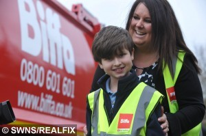 File picture of bin-mad William Bateman is collected from school by a brand new Biffa bin lorry. See Masons story MNBIN; An autistic schoolboy with a passion for recycling is now hoping to clean up with his own kid's TV show - which could be shown on NETFLIX.  William Bateman, nine, bought a full-size rusting bin lorry from Ebay for £3,500 last year on his mum's credit card while her back was turned.  Horrified Fleur Bateman managed to get a refund after realising what he had done.  But since then she has helped William develop his passion for all things recycling and he has now created environmental hero Burt the Binman.  Mum and son joined forces to write a book called 'Burt's Day Off', published in April last year, which has already sold more than 2500 copies.  They now hoping their character will move to the small screen and be as big as Bob the Builder.  The family, from St Neots, Cambs., have been working with animation company IG Media and have made a Burt the Binman pilot episode.  But they have been told the TV industry prefers to buy-in completed projects rather than develop them themselves from pilots.  Amazingly, Netflix have told the family if they can create a series they would be feature it on their site.  The Batemans hope to raise £35,000 in the next 15 days through a crowdfunding campaign launched to raise enough to create the first proper episode. 17 June 2015