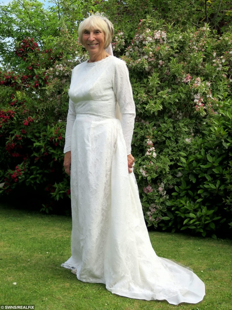 Valerie Archer who lost 83lbs to fit into her wedding dress for her golden wedding anniversary. See MASONS story MNDRESS: A grandmother slipped back into her wedding dress to celebrate 50 years of marriage - after losing six stone in just 12 months. Valerie Archer looks stunning in her beautiful dress in a black and white picture from her wedding day on May 29, 1965. The grandmother-of-one, now 69, decided to go on a diet after seeing a holiday picture last year. She joined her local slimming group and went from 16st 9lb down to 10st 10lb in just a year - just in time for her 50th wedding anniversary.