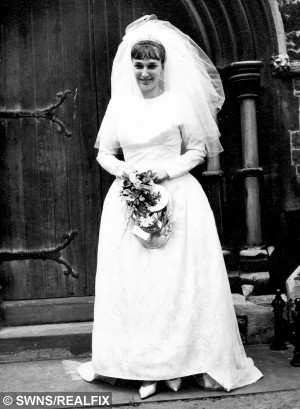 Valerie Archer on her wedding day, May 29 1965. See MASONS story MNDRESS: A grandmother slipped back into her wedding dress to celebrate 50 years of marriage - after losing six stone in just 12 months. Valerie Archer looks stunning in her beautiful dress in a black and white picture from her wedding day on May 29, 1965. The grandmother-of-one, now 69, decided to go on a diet after seeing a holiday picture last year. She joined her local slimming group and went from 16st 9lb down to 10st 10lb in just a year - just in time for her 50th wedding anniversary.