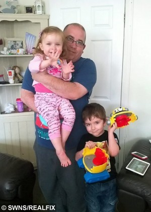 Darcie with dad Steve and brother Owen (6).  This is the dramatic moment firefighters had to rescue a two-year-old girl after she got her foot stuck in a MINION robot.  See NTI story NTIMINION.  Toddler Darcie Butler was playing with her favourite toy at 6.30am yesterday morning (Thur) when she got her leg wedged in the £40 machine.  Her mum Claire Tooth, 29, and dad Steve Butler, 38, tried to yank her foot out but were forced to call their local fire station when it wouldn't budge.  Firefighters rushed round to their home in Oldbury, West Mids., and used a hand saw to cut the robot in half in order to free brave Darcie.