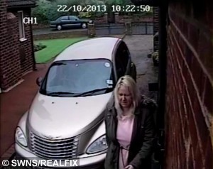 """CCTV grab shows Kirsty Robertson on the driveway of the home of neighbouring property of Mavis and Alan Ward. See Ross Parry Copy RPYHOUSE : A nightmare neighbour has been banned from contacting an elderly couple she harrassed for FOURTEEN years because she didn't like the colour of their bungalow.  Kirsty Robertson, 46, warned """"I won't stop until you're dead"""" as she made the lives of retired Mavis and Alan Ward a constant misery. A court heard they were forced to turn their 000 bungalow into a """"virtual fortress"""" and carry panic alarms in fear of what she might do next. Shocking CCTV footage showed Robertson climbing over their shared fence, pulling plant pots from their wall and throwing them on the floor. She then looked into the windows of Mr and Mrs Ward's bungalow in Thornton-Cleveleys, Lancs., shouting and pointing her finger."""