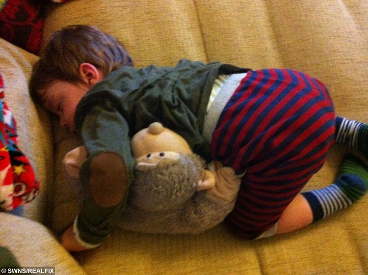 Oscar South aged 2 curled up with Monkey Pillow asleep on the sofa. Ever since Oscar's parents bought him a monkey pillow from the works in Scarborough the pair have been inseparable ever since. Sadly 'Monkey pillow' became worn out so mum Rachael began to search for a replacement pillow. Taking to social media, Rachael put out an appeal for others to help in the search. When The Works became involved, a replacement was ordered from China and flown 6,500 miles over to Oscar. See Ross Parry copy RPYMONKEY : A little boy who struggles to communicate with others had his dream come true - when strangers found a new version of his worn out monkey toy best friend and had it shipped 6,500 miles from CHINA. Three-year-old Oscar South was born 29 weeks premature and had a series of distressing operations as an infant. The tot has little verbal communication with others and is being tested for autism, but dotes on his best friend - a stuffed toy monkey called Monkey Pillow, from whom he gets distressed if separated. But when Monkey Pillow became old and tired, Oscar's family began to worry about finding a replacement. Rossparry.co.uk