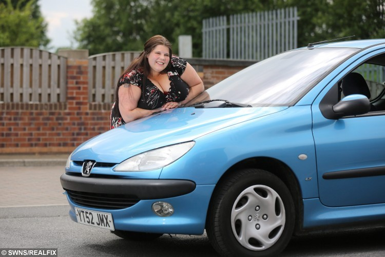 Picture shows 28-year-old Sarah Foster of Pontefract in West Yorkshire. A woman survived a horror motorway crash without a single broken bone - thanks to her huge double JJ BOOBS which acted like an AIRBAG. Mum-of-two Sarah Foster, 28, stopped in a lay-by during a family trip and jumped out the car to make a call and have a cigarette. Married Sarah was horrified when a car travelling 80mph smashed into the central reservation and was catapulted straight towards her. But the curvy mum's chest bounced straight off the windscreen and instead of being crushed into the tree with the car, she was sprung on to the road. Ian Hinchliffe / Rossparry.co.uk