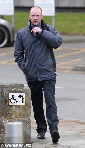 ***Ammended caption to picture filed earlier today*** Picture shows Martyn Darlington arriving at Mold Crown Court. See Ross Parry Copy RPYVIDEOS : A man secretly filmed his 15-year-old step-daughter undressing, washing and going to the toilet, a court heard.  Sick Martyn Darlington, 39, spied on Jade Walsh using cameras he set up in her bedroom and the bathroom of the family home he shared with her mother Caroline.  He was today jailed for 14 months at Mold Crown Court after admitting he also built up a collection of indecent photographs and videos of children as young as six. Prosecutor Karl Scholz told the court Jade Walsh was the daughter of a woman that Darlington lived with and had been going out with for around eight years. He said that at the age of 16, she left the family home but from the age of 11, they were living at the same house.  Thomas Temple/Rossparry.co.uk