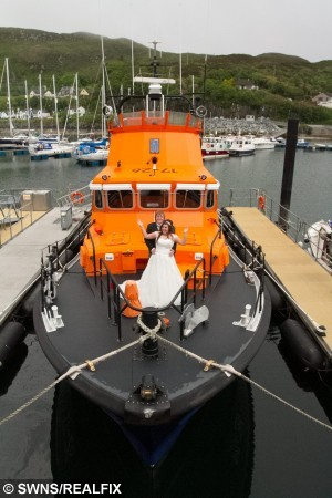 Sophie Anderson and Richard McWhirter pose up for pictures onboard the Mallaig Lifeboat after it returned from a call. See Centre Press story CPWEDDING; A couple have got married in a harbour – after the lifeboat they were due to wed on got called out to an emergency. Sophie Anderson and Richard McWhirter were due to exchange vows on a lifeboat yesterday (Sat). But at the last minute the RNLB Henry Alston Hewat was called out to a shout, leaving the couple to marry at the harbour-side. The lifeboat was not even the Buckie, Moray couple's first choice of venue, after originally planning to hold the ceremony on the Jacobite steam train at Glenfinnan viaduct.