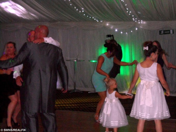 Mike Snell on the dancefloor on his wedding day - seconds later he was on the floor having torn almost every ligament in his left knee. See SWNS story SWDIRTY; A groom nearly died after he broke his knee on his wedding day - doing the DIRTY DANCING lift. Mike Snell, 36, had just walked down the aisle with his new wife Cerise, 28, when they hit the dance floor for a party with their family and friends. The dad-of-four requested the DJ play classic Time of My Life - made famous for the epic overhead lift - so he could have a romantic dance with his new bride. But he was astonished when his wife's work colleague unexpectedly ran at him, thinking the new groom would lift her up just like Baby in the 1987 movie.