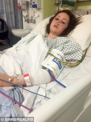 Zoe Turner pictured in hospital recovering after her red body con dress saved her life. See SWNS story SWDRESS: A Christmas party-goer who was hit by a CEMENT MIXER on her way home was saved by her skin-tight bodycon dress - which stopped her bones piercing her internal organs. University graduate Zoe Turner, 21, splashed out £34.99 on the little red dress from online retailer Missguided and squeezed into it for a festive bash. But disaster struck when her taxi home was hit by a cement mixer, which left Zoe and her three friends with life-threatening injuries. Incredibly, doctors told Zoe that her bodycon dress was so tight it stopped her bones from popping out and perforating her vital organs.