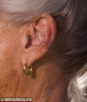 """Christine Bowden from Looe, Cornwall, wearing her new hearing aid. 30/06/2015 A profoundly deaf woman saved the lives of two stricken sailors after she heard their desperate cries for help - thanks to new HEARING AIDS she had fitted the day before. See swns story SWHEAR. Christine Bowden, 77, was in her coastal garden when she heard one of the men calling about half a mile out to sea. She alerted her husband Marcus and they grabbed their binoculars and spotted an upturned dinghy in the distance - but no sign of any occupants. But the shouts continued so they raised the alarm and the RNLI scrambled two lifeboats. Emergency services found one man in a life jacket desperately trying to swim back to shore and a second clinging to the hull of the upturned 10ft boat without a life jacket. The first of the two was suffering from hypothermia and close to exhaustion when he was hauled from the water.The second was also rescued and their boat was righted and towed back to the shore at Looe, Cornwall.The lifeboat crew told Christine the men - two middle-aged holidaymakers - probably owed their lives to her and her two new hearing aids.Christine, a retired secretary, said: """"They were very lucky as I had just got my hearing aids. """"I only picked them up on Friday morning and this all happened on Saturday afternoon.""""I was virtually deaf before and had them for less than 24 hours.  """"If it had happened the day before I may not have heard them - and who knows what would have happened."""""""