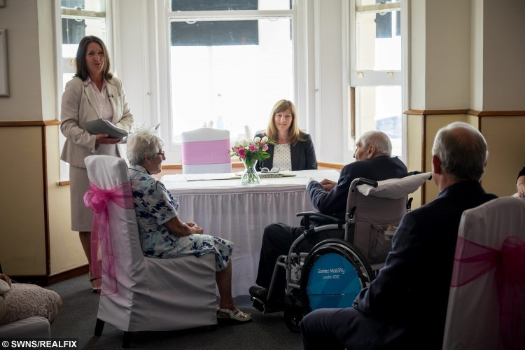 """George Kirby aged 103 marries his girlfriend of 27 years Doreen Luckie, 91. A British couple who became the world's oldest newly-weds 'consummated' their marriage - with TEA and BISCUITS.See swns story SWWED. George Kirby and Doreen Luckie signed their way into the record books thanks to their combined age – of almost 195.Devoted George, who turned 103 on his big day on Saturday, said he had a """"lovely day"""" finally getting hitched to partner of 27 years Doreen, 92.But when the pair retired to their special hotel suite on the wedding night George hung a """"do not disturb"""" sign on the door – before they tucked into tea and biscuits.Retired RAF-veteran George said: """"We had a lovely day, and it was great seeing everybody.""""We were quite tired when we finally made it to our room, so I put the do not disturb sign on the door and ordered up some tea and biscuits.""""I'd had quite enough excitement.""""They wed in front of around 50 delighted guests and a representative from Guinness with a combined age of a record-breaking 194 years and 281 days.The loved-up pair have been together for 27 years, and George finally proposed on Valentine's day – after giving in to pressure from their elderly children."""