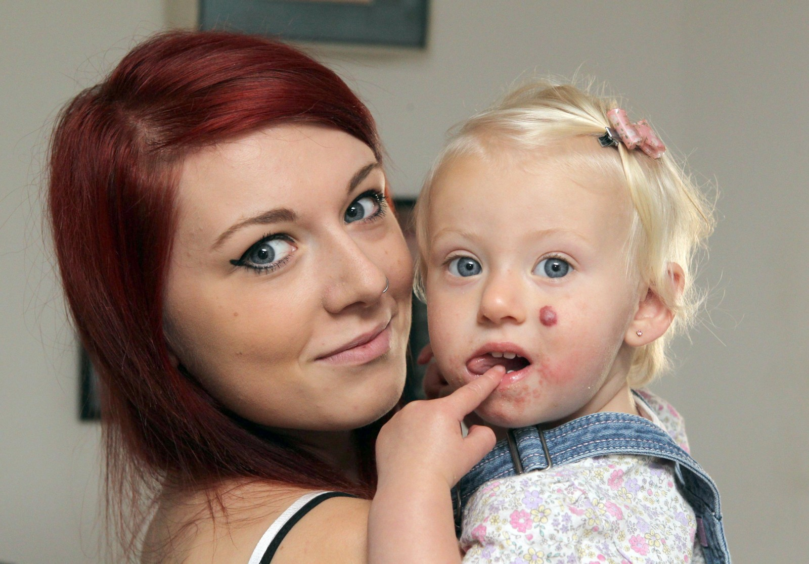 'How could they airbrush my perfect daughter?' Mum's fury at photography firm