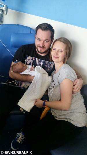 Mum Samantha Woodgate with husband David and their son George. Samantha found out she had  thyroid cancer after having her seventh child.See MASONS story MNCANCER; A mum-of-seven discovered she was pregnant the day she went into hospital - to be STERILISED. Samantha Woodgate, 32, was in hospital in July 2014 waiting to have the procedure when she found out she was pregnant with her seventh child. The former shop assistant and her husband David, 34, had made the decision that their family was big enough and they didn't want anymore children. But they were too late - as Sam was already eight-and-a-half weeks pregnant by the time she went into hospital.