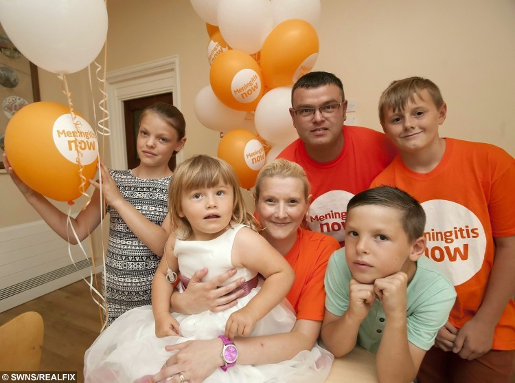 "(LtoR) Kathy Norman. Martha Norman. Nicola Norman (Mum). Mitch Norman (Dad). Zak Stephens. Callaum Norman at Little Treasures Charity launch. A brave toddler has survived meningitis twice after being struck down with two bouts of the deadly infection in just five months. See Masons story MNTWICE. Martha Norman had a greater chance of winning the lottery than contracting the same strain of bacterial meningitis twice. The two-and-a-half year-old pulled through despite suffering a stroke, septicaemia, surgery and a medically induced coma.  The odds of contracting meningitis twice are said to be 14 million to one -  Parents Nicola and Mitchell knew something was wrong when Martha woke up one morning in September and seemed ""floppy"".  When Martha continued to be drowsy and started vomiting Nicola rushed her straight to hospital. The potentially lethal 7F bacterial strain of the disease meant there was no sign of the tell-tale rash associated with its more manageable viral form. Ten per cent of  bacterial meningitis cases are fatal and around 15 per cent of people who contract the strain are left with severe physical difficulties.  Martha was diagnosed with meningitis and was immediately transferred to Addenbrooke's Hospital, a leading university teaching hospital in Cambridge. After months of antibiotics, physiotherapy and a long hospital stay the family hoped  the worst was behind them. But in an extremely rare turn of events Martha contracted a second strain of meningitis in February. Nicola said: ""I recognised the signs from the first time, I called 111 and they told me to wait 24 hours but I wasn't happy with that so I took her to hospital straight away. ""We caught it so early we didn't give it a chance."" Doctor's confirmed Martha had contracted the disease a second time, put her on antibiotics immediately and kept her in hospital for a week."