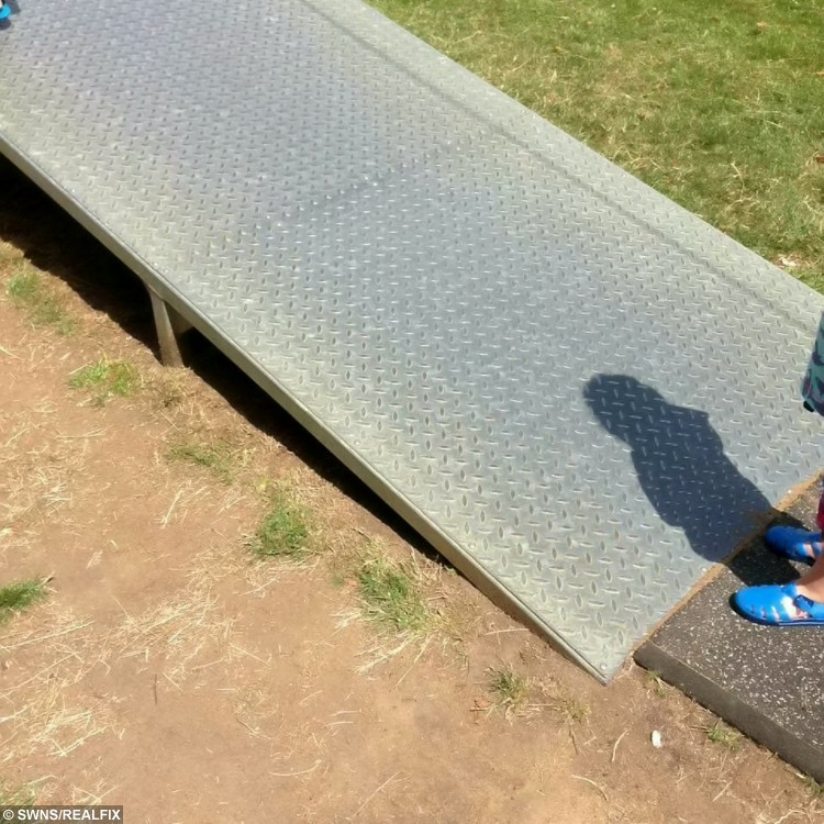 The metal ramp where Little Riley Doherty was burnt. See MASONS story MNBURN; A toddler has been left in agony after get?ng burned by a piece of playground equipment which heated up in sizzling summer conditions.  One-year-old Riley Doherty was enjoying the weather at the Parson's Close Rec play- ground in Leighton Buzzard  on Friday, before he decided to clamber up a ramp leading to a zipwire. But the sheet metal ramp scorched the infant's legs and right hand, leaving him howling in pain.  Like most of the region, Leighton Buzzard enjoyed sweltering conditions on Friday, as temperatures soared to more than 25c.  Little Riley Doherty. See MASONS story MNBURN; A toddler has been left in agony after get?ng burned by a piece of playground equipment which heated up in sizzling summer conditions.  One-year-old Riley Doherty was enjoying the weather at the Parson's Close Rec play- ground in Leighton Buzzard  on Friday, before he decided to clamber up a ramp leading to a zipwire. But the sheet metal ramp scorched the infant's legs and right hand, leaving him howling in pain.  Like most of the region, Leighton Buzzard enjoyed sweltering conditions on Friday, as temperatures soared to more than 25c. The metal ramp where Little Riley Doherty was burnt. See MASONS story MNBURN; A toddler has been left in agony after getfing burned by a piece of playground equipment which heated up in sizzling summer conditions.  One-year-old Riley Doherty was enjoying the weather at the Parson's Close Rec play- ground in Leighton Buzzard  on Friday, before he decided to clamber up a ramp leading to a zipwire. But the sheet metal ramp scorched the infant's legs and right hand, leaving him howling in pain.  Like most of the region, Leighton Buzzard enjoyed sweltering conditions on Friday, as temperatures soared to more than 25c.  Little Riley Doherty. See MASONS story MNBURN; A toddler has been left in agony after getfing burned by a piece of playground equipment which heated up in sizzling summ