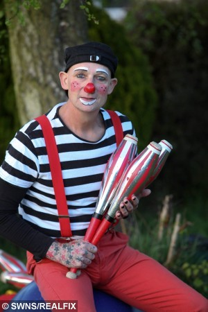"""CLown Wayne Oakes aged 47. See SWNS story SWCLOWN; A father-of-four refused to let a grim throat cancer diagnosis get him down and continued to work during treatment – as a CHILDREN'S CLOWN. Wayne Oakes, 47, beat cancer blues by slapping on white face-paint, clipping on his squeaky red nose, and bringing joy to scores of children as his happy-go-lucky clown persona Mister Mudge. The beloved children's entertainer reckons putting on a brave, but silly, face every day helped him in his year-long battle with cancer, which is thankfully in remission. Wayne, of Irchester, Northamptonshire, said: """"Being dressed up made me feel a million miles away from being a cancer patient."""