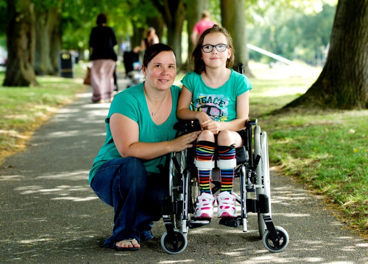 Emma Haynes with her daughter Olivia Haynes (8) who has cerebral palsy.  A single mum has told how she had to diagnose her premature baby's cerebral palsy using the internet after doctors repeatedly ignored her concerns about her movement and muscles.  See NTI story NTIGOOGLE.  Little Olivia Haynes was diagnosed with permanent disorder cerebral palsy some eight months after her mum raised worries about her coordination, limbs and balance. She now faces years of gruelling physiotherapy and could be wheelchair-bound for the rest of her life.  Her mum Emma, 36, first noticed something was seriously wrong when her daughter was unable to move as a baby and had stiff muscles and limbs.  The concerned mum-to-four took Olivia to her local GP, a paediatrician and a health visitor, who all dismissed her fears, saying the child was just slow in her development.  But Emma, of Evesham, Worcs., was convinced her daughter's condition was more serious after googling her symptoms on the internet.