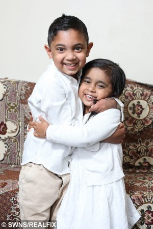 "Picture shows Haseeb Ahmed with his younger sister Hannah at their home in Rotherham, South Yorkshire. See Ross Parry copy RPYBLOOD : A youngster with a life threatening blood disease has been completely cured - after receiving his little sister's ""magic blood"". Little Haseeb Ahmed, six, is enjoying life and bursting with energy for the first time in his life. But his sprightliness is a far cry from how he used to be, with his condition meaning his blood struggled to carry oxygen around his body resulting in spells of tiredness. Football lover Haseeb was born with rare disorder beta thalassemia major and was in and out of hospital receiving regular blood transfusions. Rossparry.co.uk/Ian Hinchliffe"
