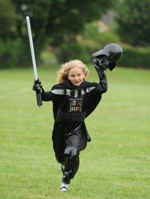 "Picture shows Izzy Cornthwaite in her Darth Vader after winning an intergalactic battle with Disney to relabel the outfit. See Ross Parry copy RPYVADER : An eight-year-old female Star Wars fan forced DISNEY to change its labelling policy after she complained her Darth Vader costume was marked ""for boys"". Izzy Cornthwaite was disappointed to find the distinctive outfit she wanted to wear was classed not for girls - so she wrote to the industry giant to complain. Her concerns were so inspiring that the international company changed its policy, and now all outfits sold in the Disney Store are labelled as ""for kids"". Izzy's mum Becky Heyes said: ""All the Star Wars collection was for boys. There was no Princess Leia suit or anything to do with girls. ""A few weeks later, Disney told Izzy that they would change the description from ""boys"" to ""kids""."