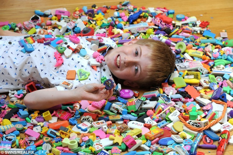 "Picture shows nine-year-old Matthew Waring of Goosnargh, Lancashire. who has a collection of more than 3,500 rubbers. See Ross Parry copy RPYRUBBERS : A nine-year-old lad has a quirky ambition to make it in to the record books by amassing the largest collection of rubbers the world has ever seen. Matthew Waring is so determined to grasp the the coveted title that he has managed to amass more than 3,500 erasers over the past few years. Proud of his work in progress, award-winning vegetable grower Matthew occasionally gets his rubber stash out and puts them on display, or to play with them when his friends come round.  Mum Heather explains: ""We got him the Guinness Book of Records one year for Christmas, and he decided he wanted to beat one."