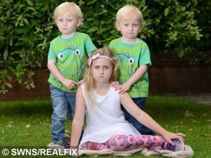 Pictured - Sophie Parkinson with her brother Daniel and Alex. See Ross Parry Copy RPYSAVE :  A brave girl saved her three-year-old brother's life when a 40ft TREE fell on them as they played on an inflatable slide. Quick-thinking Sophie Parkinson, seven, dragged little Daniel to safety as he lay trapped beneath a pile of branches. They were sat on the top of the slide with their brother Alex when the tree trunk split in two and began to plummet towards the children.  Thomas Temple/rossparry.co.uk