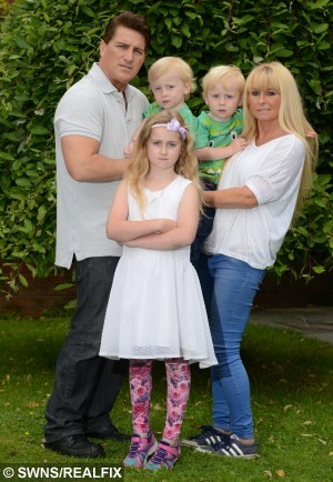 Pictured - Sophie Parkinson with her brothers Alex and Daniel and parents Mike and Donna Parkinson. See Ross Parry Copy RPYSAVE :  A brave girl saved her three-year-old brother's life when a 40ft TREE fell on them as they played on an inflatable slide. Quick-thinking Sophie Parkinson, seven, dragged little Daniel to safety as he lay trapped beneath a pile of branches. They were sat on the top of the slide with their brother Alex when the tree trunk split in two and began to plummet towards the children.  Thomas Temple/rossparry.co.uk