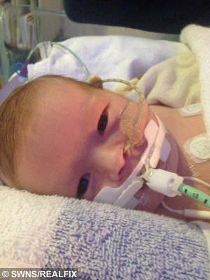 Pictured -Minnie, who passed away only 23 days old. Duggleby, from Yorkshire. See Ross Parry copy RPYTRANSPLANT. Thier second child Minnie, who passed away only 23 days was a Neonatal Ogan Donor.