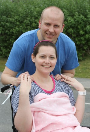 Pictured - Sarah Kelly and fiance Lee Killon both aged 34, were getting married but 10 days before the wedding Sarah, who had been experiencing pains in her hegs, was suddenly diagnosed with a huge tumour near her spine. See Ross Parry copy RPYTUMOUR. A bride-to-be was forced to cancel her wedding just days before she was due to marry - after being told her HONEYMOON could paralyse her. Sarah Kelly, 34, had a tumour the size of an egg pushing on her spine and was told the cabin pressure on her planned flight to Mexico would leave her wheelchair-bound for life. After undergoing a risky operation to remove the mass, she now has to learn to walk again - and hopes to be back on her feet by February, when she and husband  Lee finally plan to marry.