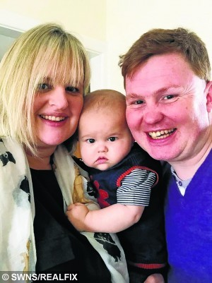Collect of Daniel Cornet from Dunfermline, Fife,with his parents Lousie Paton and Nick Cornet. See Centre Press story CPBABY; A baby boy who was diagnosed with chronic kidney disease when he was born three weeks early is one of the country's youngest dialysis patients. Little Daniel Cornet has endured eight nerve-wracking operations in the last 10 months – three of which were carried out in the first month of his life alone. Since his birth on August 8 last year, his kidney function has only ever been at 10 per cent at best and, since November, the brave little fighter has been battling end-stage renal failure.
