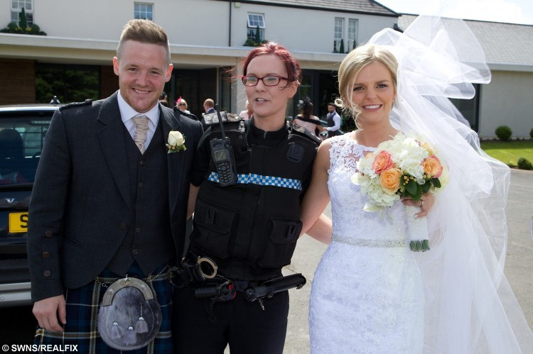 Collects of the wedding of Stephanie Ritchie and David Ritchie, pictured with PC Lynsey Arthur, at the Lochside House Hotel in New Cumnock, where the couple received a helping hand from a passing police car when their own wedding car broke down. See Centre Press story CPBRIDE; A blushing bride spent her special day in the back of a police car - after her bridal vehicle broke down and an officer rushed her to the wedding reception. Bride Stephanie Ritchie has praised the police officer who went beyond the call of duty after passing the scene of the breakdown. Stephanie and groom, David Ritchie, had tied the knot at Thomas Coats Memorial Baptist Church in Paisley before they headed for a reception with friends and family. But the newlyweds were left standing at the side of the road when their car broke down.