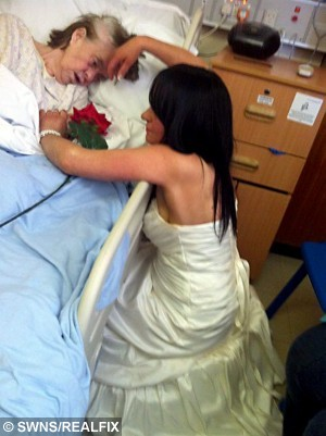 FILE PICTURE The touching moment that Lisa Bullock donned her wedding dress to visit her terminally ill mother Nelly Bullock. See SWNS story SWDRESS: The woman who touched millions of hearts when she wore a wedding dress to visit her terminally-ill mum included her dead parents on the big day - by taking 70 guests to visit their graves. Caring Lisa Bullock-Hoskins, 44, finally tied the knot with her partner of 27 years Robert Hoskins, in an intimate ceremony with family and friends. But as a sad tribute to her deceased parents Nelly and Michael, Lisa and Rob took a bus full of 70 guests to Coney Hill cemetery in Gloucester. Grandmother Nelly Bullock, 70, had always wanted to see her beloved Lisa tie the knot, but she was struck down by Creutzfeldt-Jakob Disease (CJD) - a form of the degenerative brain disorder linked to Mad Cow Disease. Her conditioned worsened, and it was clear that Nelly would not live to see their September 7 wedding day, so Lisa made the heart-breaking decision to show her former market trader mum the dress before it was too late