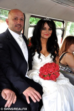 Lisa and Rob on their wedding day. See SWNS story SWDRESS: The woman who touched millions of hearts when she wore a wedding dress to visit her terminally-ill mum included her dead parents on the big day - by taking 70 guests to visit their graves. Caring Lisa Bullock-Hoskins, 44, finally tied the knot with her partner of 27 years Robert Hoskins, in an intimate ceremony with family and friends. But as a sad tribute to her deceased parents Nelly and Michael, Lisa and Rob took a bus full of 70 guests to Coney Hill cemetery in Gloucester. Grandmother Nelly Bullock, 70, had always wanted to see her beloved Lisa tie the knot, but she was struck down by Creutzfeldt-Jakob Disease (CJD) - a form of the degenerative brain disorder linked to Mad Cow Disease. Her conditioned worsened, and it was clear that Nelly would not live to see their September 7 wedding day, so Lisa made the heart-breaking decision to show her former market trader mum the dress before it was too late.
