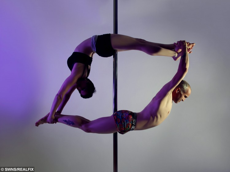 """Father and daughter pole dancing team Dave and Hazel Roberts. See SWNS story SWPOLE: The world's first father-daughter pole-dancing duo has made it to the final of a national competition. Dave and Hazel Roberts, of Gorse Hill, will take to the pole at the UK doubles championships in Birmingham on October 4. The national recognition marks the pinnacle of their pole-dancing journey, which got under way after a coincidence three years ago. The 50-year-old B&Q team leader discovered a talent for swinging round the pole when he accompanied a former girlfriend to Emily's Pole Fitness in Cheney Manor. """"I just kept going and I enjoyed mastering new moves and the strength I was building up. It was difficult at first because I was the only man, I've gone from 15 stone to 11 stone and I feel so much better in myself,"""" Dave said."""