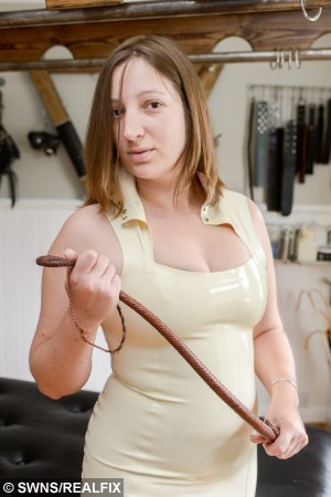 """Mistress Evilyne photographed in her dudgeon, Orpington Kent. See SWNS story SWWHIP; An Orpington dominatrix has defended her secret fetish dungeon offering caning, spanking and bondage after neighbours complained to police. Quietly operating in the Knoll area as The Dungeon Manor, the play space takes bookings on the internet before directing clients to a house where they can be blackmailed, restrained or humiliated for their pleasure. From the outside it is a large, detached home on a quiet, leafy street but inside is a thriving fetish establishment, which boasts on the internet of offering """"a comfortable and convenient domestic setting for play, filming and photography"""". Neighbours have complained to the police over its existence with some claiming to have heard """"whipping"""" and """"screaming"""" coming from the address."""