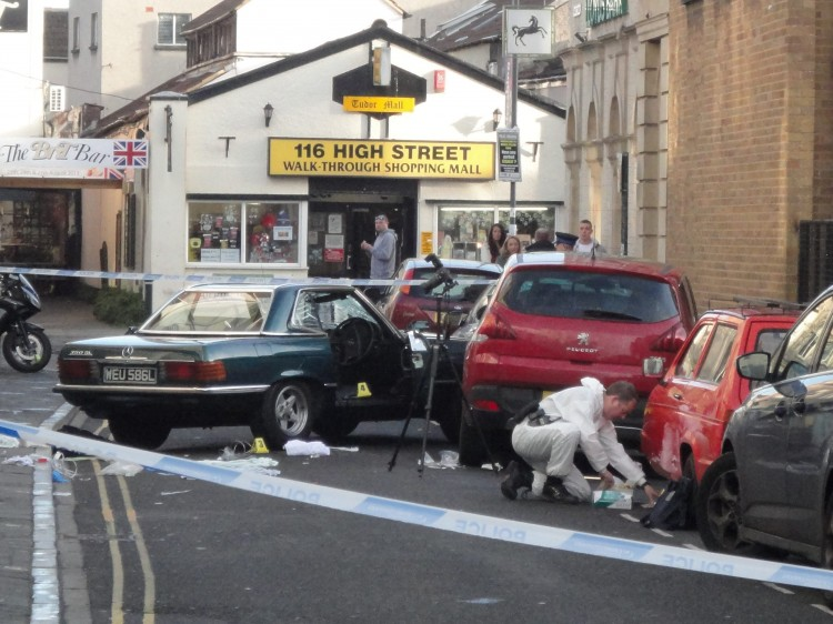 The scene in Weston Super Mare where a man was left fighting for his life in a row over a parking space. See SWNS story SWNOSE: A man died four times and was left disabled for life after he was run over THREE TIMES in a row over a parking space. John Crowley wanted to park his classic green Mercedes 350 in the last spot on a street but was blocked by Peter Cox, who was standing in it reserving it for his son. Crowley, 44, edged his car slowly towards Mr Cox, who refused to move and was knocked to the ground. Mr Cox's son Craig saw what was happening and smashed the windscreen of Crowley's car in a bid to stop the row.