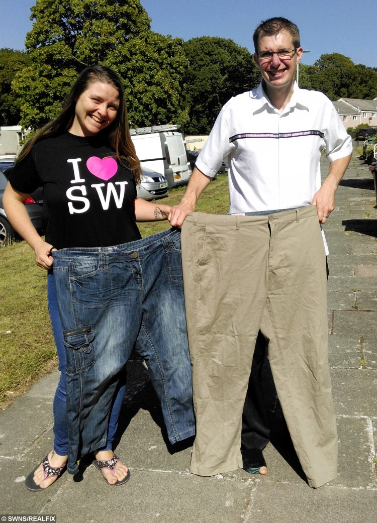 Peter and Tracey Needham pictured after they both worked to acheive a dramatic weightloss. See SWNS story SWCHICKEN; A couple who have shed a combined weight of 16 stone say they couldn't have done it without drastically changing their diet- which now includes Weetabix chicken. Peter Needham, aged 36, and his wife, Tracey, 32, both weighed 20 stone back in March 2009. They were due to marry in November of that year, and saw the wedding as the perfect opportunity to slim down. In 8 months, Peter dropped from 20 stone to 13 and Tracey went from 19 and a half to 13. The couple used to spend £50 a week on takeaway, but with the help of a Slimming World diet, which focuses on eating a lot and avoiding particularly fatty foods, they now make all their meals at home. A favoured meal of theirs is Weetabix chicken, a healthy alternative to eating KFC made by coating chicken in a Weetabix crumb mixture.