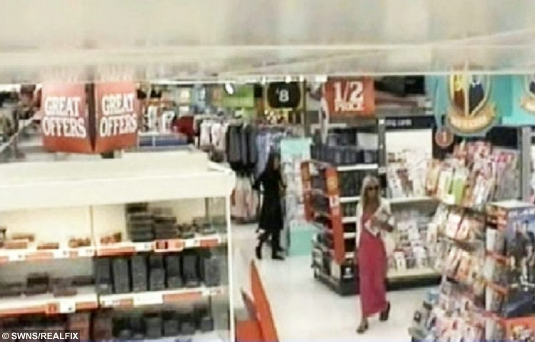 Last picture of Jane Wiggett walking through the aisles of Sainsbury's.  A grandfather who murdered his ex-wife and hid her body in bed where she lay undiscovered for weeks even when family searched her home has been jailed.  See SWNS story SWBED.  Evil Daniel Spencer, 59, strangled Jane Wiggett, 57, and tucked her under blankets, a duvet and pillows.  Spencer then went on the run and told friends and family she had gone on holiday to Cornwall.  Her loved ones began to have concerns when she didn't contact them and looked for her at her flat - but didn't spot her in bed.  It wasn't until concerned relatives alerted the police that Jane's body was found a month later and Spencer was arrested almost 60 miles away, near Birmingham Airport.  Spencer, who was married to Jane for 30 years, was yesterday (Wed) sentenced to a life in prison with a minimum of 16 years following a 12 day trial.