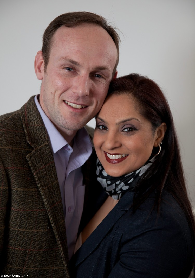 DUDLEY, UNITED KINGDOM, FEBRUARY 13, 2013: John Walker and fiance Neilum Raqia from Dudley who has appeared in hundreds of tv programmes as an extra.    See NTI story NTIEXTRA.  Britain's most dedicated TV extra has been revealed to be a Tesco fish counter worker who has clocked up a staggering 2,000 appearances on the nation's best-loved dramas, soaps and comedies.  John Walker, 40, has been cropping up in the background of over 200 different TV programmes for the last 14 years.  Despite amassing 70 hours on screen - the equivalent of 35 feature length films - John remains unheard of preferring instead to be a face in the crowd.  He has worked on programmes which include, Coronation Street, Eastenders, Dr Who, Gavin and Stacey, Emmerdale Farm and Waterloo Road.