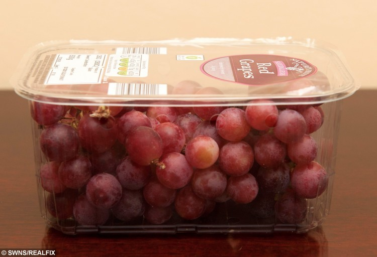 Grapes like the ones purchased by Jamie Swinney, 67, from a local Aldi store where he found a young black widow spider inside.  A unsuspecting pensioner was left shocked after he found a deadly black widow spider - crawling in a bunch of Aldi grapes.  See NTI story NTIGRAPES.  Jamie Swinney, 67, reached for a handful of red grapes he had bought from the supermarket when he spotted a black and red insect wriggling in the punnet.  The stunned grandfather recognised the infamous creepy crawly at once, grabbed some clingfilm and wrapped up the lethal critter before dialling 101.  Police called Nuneaton and Warwickshire Wildlife Sanctuary boss Geoff Grewcock, who rushed over, confirmed it was the killer arachnid and took it away.