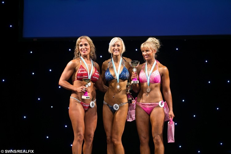 "Bodybuilding champion Sarah Oldham (32) (C) from Northampton.  A woman who was left mortified after seeing a photo of herself as a buxom bridesmaid has turned her life around by losing six stone and becoming a bodybuilding champion.  See NTI story NTIBODY.  Sarah Oldham, who tipped the scales at 16st at her largest, got a wake up call after squeezing into a curvaceous size 22 bridesmaid's dress for her sister's wedding.  11 years later, after numerous diets and gruelling exercise regimes failed to give the results she needed, the 32-year-old, from Duston, Northants., decided enough was enough.  Ms Oldham, an insurance claims team leader, took up bodybuilding 18 months ago and now weighs a toned eight-and-a-half stone, after following a strict diet of chicken, broccoli and rice.  On weekends, her personal trainer allows her to branch out and eat salmon, sweet potato and a small amount of carbohydrates.  Speaking of the moment she realised she needed to change her eating habits, Sarah said: ""I was a bridesmaid for my sister's wedding a few years ago and was mortified when I had to wear a size 22 dress.Ã"